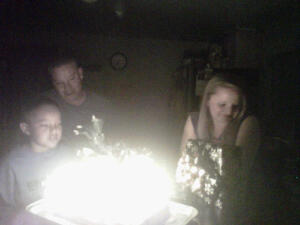 ~Isaiah, Thomas and Laura listen as we sing Happy Birthday~  :)